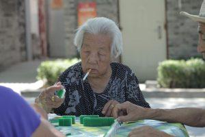 Dia 26 Escena cotidiana de un Hutong, Jugando al Mayong, el domino chino